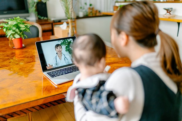 woman and baby doing video chat with doctor